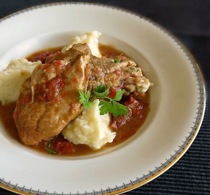 Chicken casserole in tomato sauce with mashed potatoes