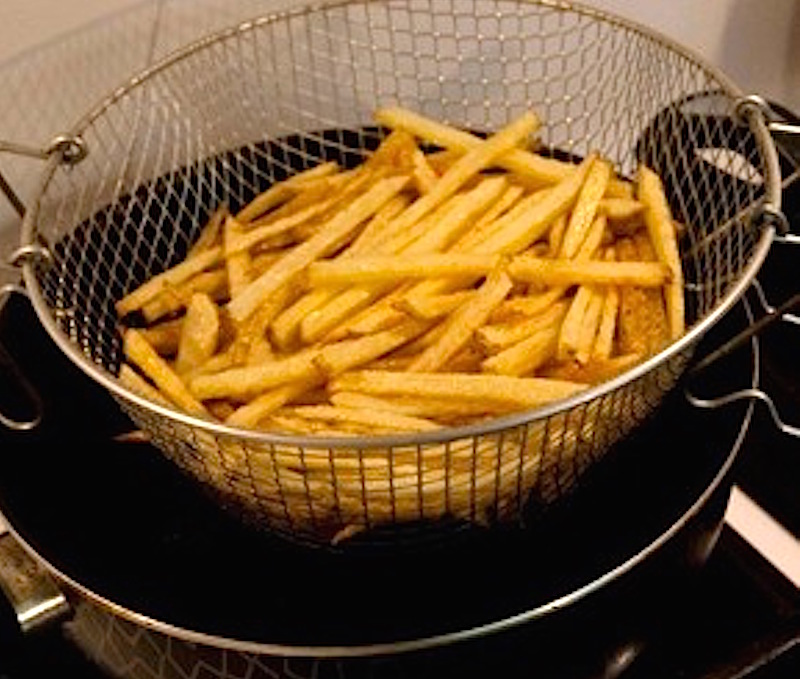 crispy unpeeled fried potatoes