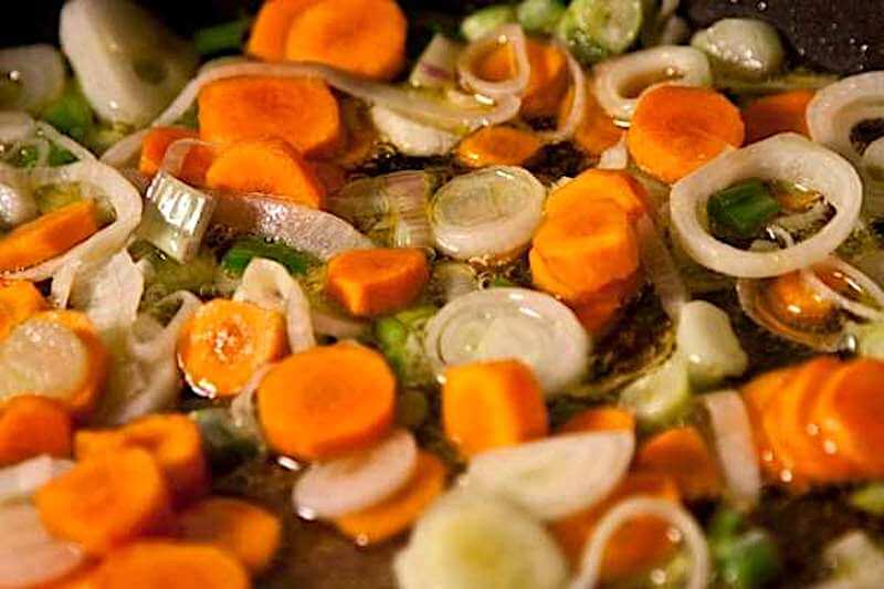 sauteing the carrots and sliced spring onions