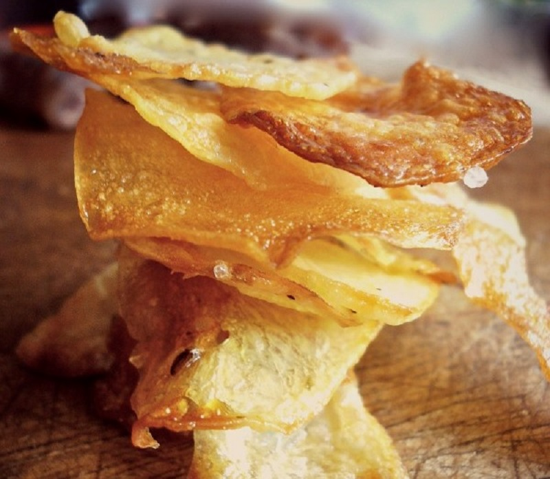 Homemade crispy potato chips oven-baked