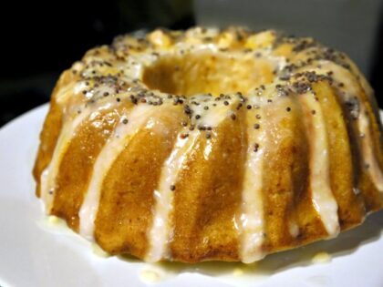 juicy and scented lemon cake with lemon icing and poppy seeds