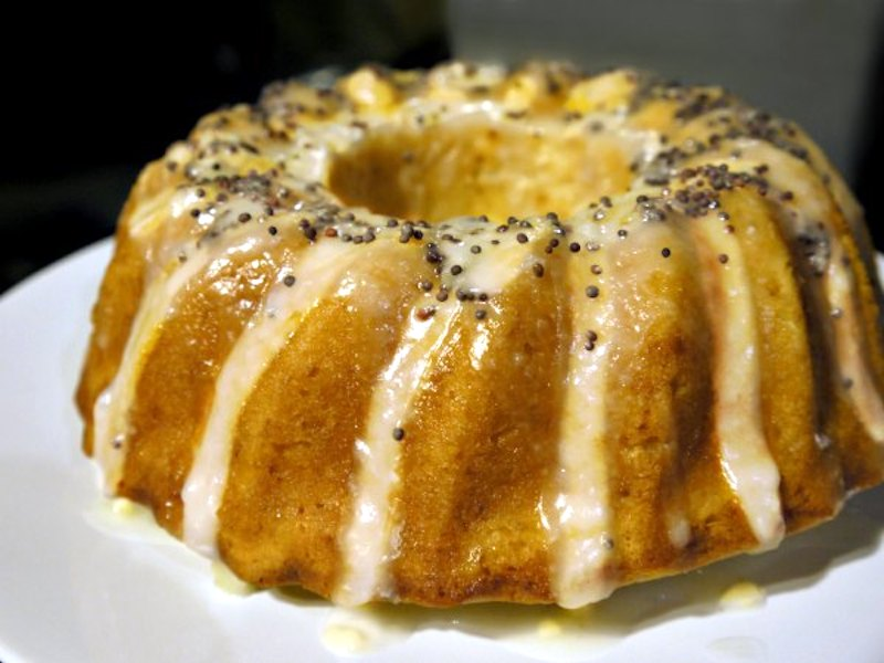 Moist, scented lemon cake with lemon icing and poppy seeds
